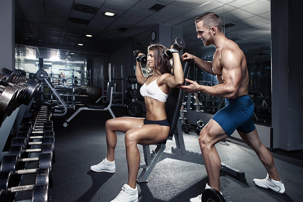 Fitness Couple Lifting