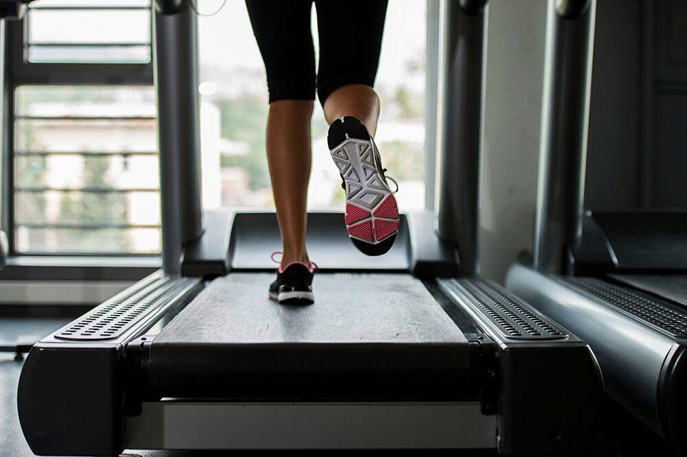 Woman running treadmill