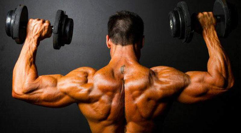 Man with a strong back and traps